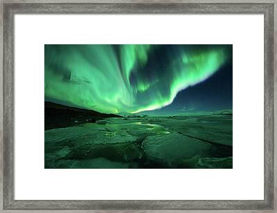 Aurora Display Over The Glacier Lagoon Framed Print by Natthawat