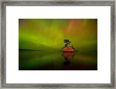 Aurora Over Honeymoon Rock In Lake Superior Framed Print by Jeff Rennicke