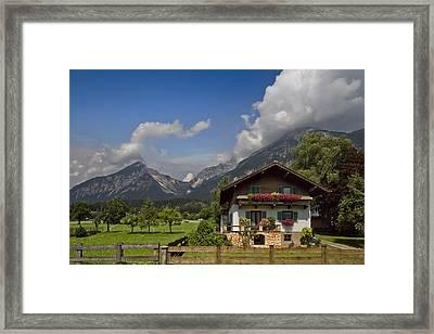 Austrian Cottage Framed Print by Debra and Dave Vanderlaan