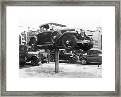 Auto Repair Shop Lift Framed Print by Underwood Archives