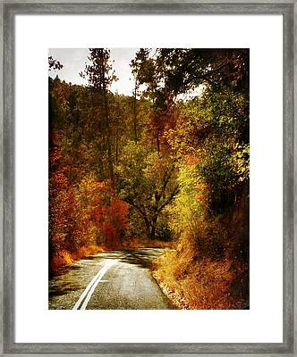 Autumn Highway Framed Print by Leah Moore