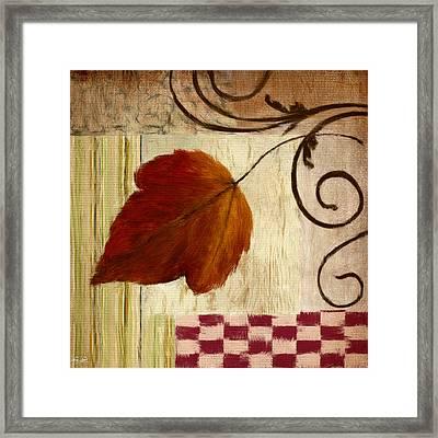 Autumn Leaf Framed Print by Lourry Legarde