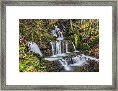 Autumn Waterfall Framed Print by Ian Mitchell