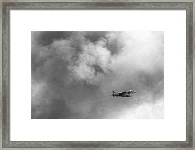 Av-8b Harrier Flies Through The Smoke Of War Framed Print by Peter Tellone