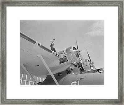 Aviation Mechanics Check The Huge Motor Framed Print by Stocktrek Images