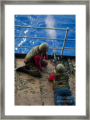 Aviation Ordnanceman Fires A M240 Framed Print by Stocktrek Images