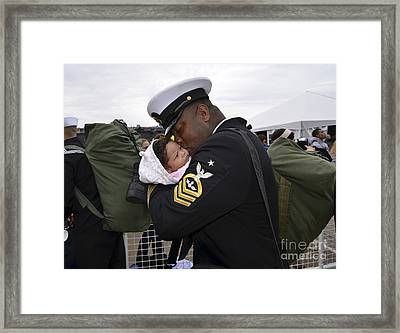 Aviation Ordnanceman Kisses His Newborn Framed Print by Stocktrek Images