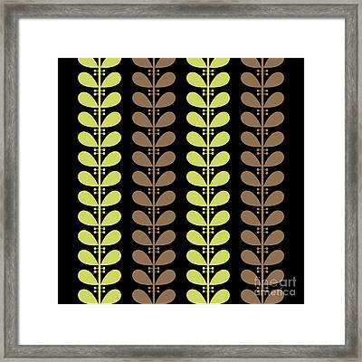 Avocado And Brown Leaves On Black Pillow Framed Print by Donna Mibus