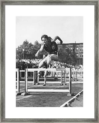 Babe Didrikson High Hurdles Framed Print by Underwood Archives