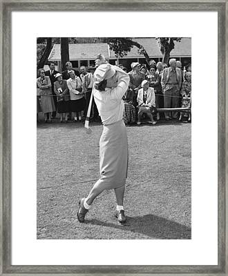 Babe Didrikson Teeing Off Framed Print by Julian Graham