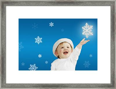 Baby And Snowflakes Framed Print by Kelly Redinger