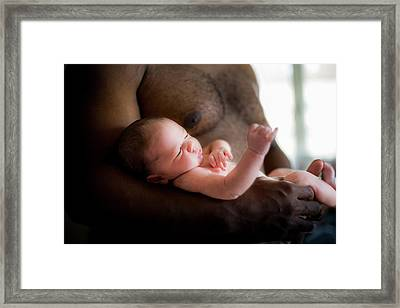 Baby Boy Being Cradled By His Father Framed Print by Samuel Ashfield