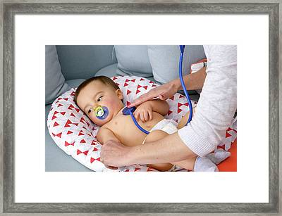 Baby Boy Being Examined By A Doctor Framed Print by Aj Photo