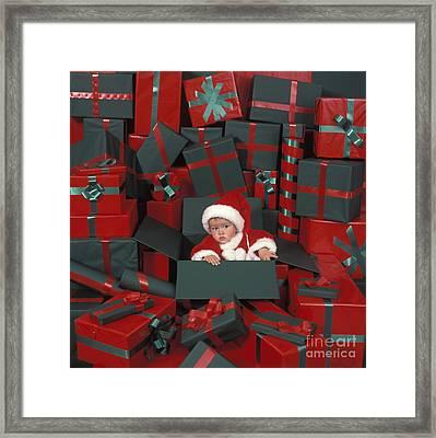 Baby In Christmas Box Framed Print