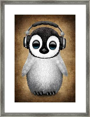 Baby Penguin Dj With Headphones Framed Print by Jeff Bartels