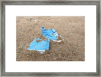 Baby Shoes On Beach Framed Print