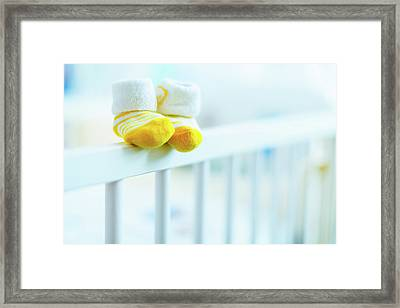 Baby Shoes On The Edge Of A Cot Framed Print by Wladimir Bulgar