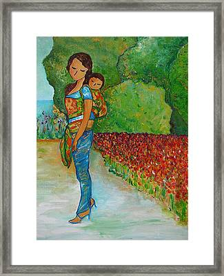 Baby Wearing In The Green Framed Print by Gioia Albano