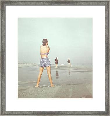 Back View Of Three People At A Beach Framed Print