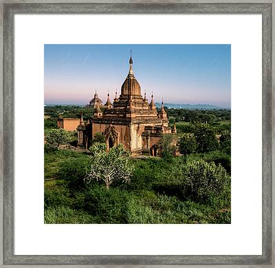 Bagan, Ancient Temple Lit By Moonlight Framed Print by Martin Puddy