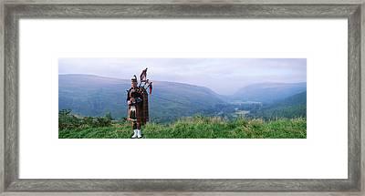 Bagpiper At Loch Broom In Scottish Framed Print