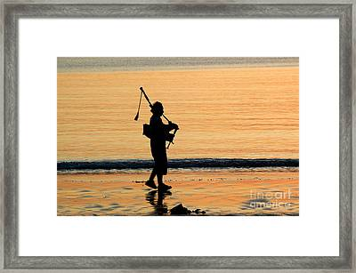 Bagpiper At Sunset Framed Print