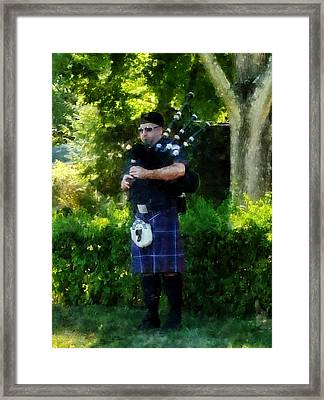 Bagpiper Framed Print by Susan Savad