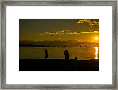 Balancing Into The Sunset Framed Print