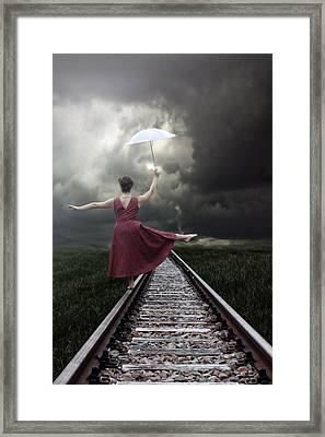 Balancing Framed Print by Joana Kruse