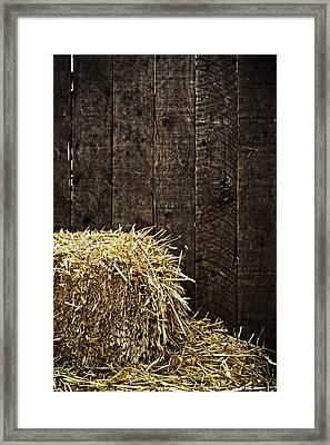 Bale Of Straw And Wooden Background Framed Print