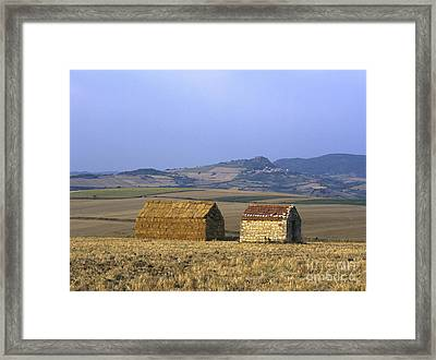 Bales Of Straw Stacked In The Shape Of A House Next To A Little Stone House. Limagne. Auvergne. Fran Framed Print