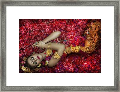 Balinese Woman Among The Flowers Framed Print