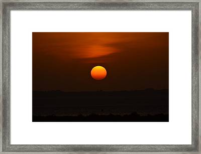 Ball Of Fire Framed Print by Debra Martz