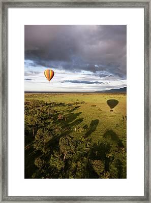 Balloon In Masai Mara National Park Framed Print by Luis Davilla