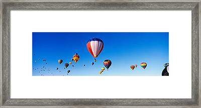 Balloons Floating In Blue Sky Framed Print by Panoramic Images