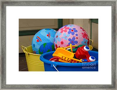 Balls And Toys In Buckets Framed Print