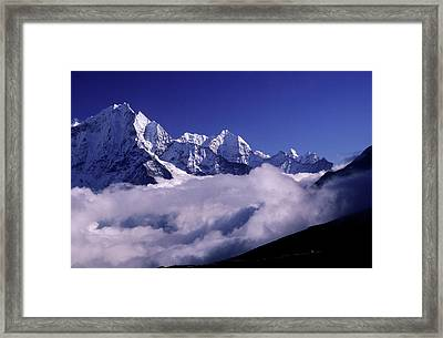 Bank Of Heavy Clouds Rolls Up The Gokyo Framed Print by Paul Dymond
