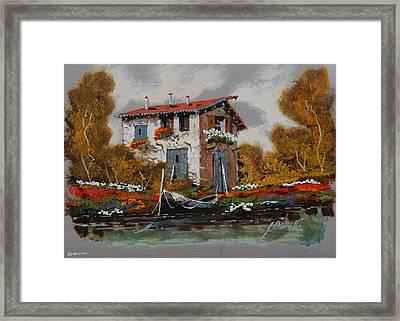 Barca Al Molo Framed Print by Guido Borelli