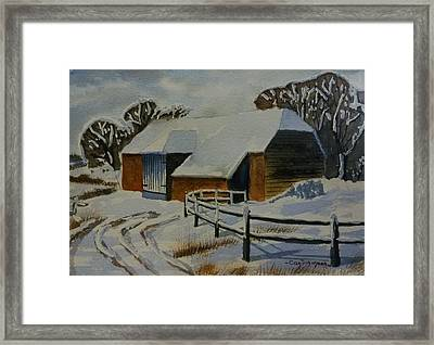 Barn In Snow Framed Print by Can Dogancan