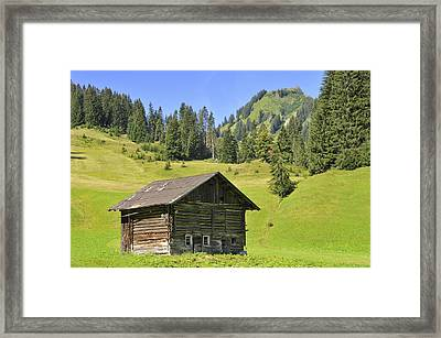 Barn On Green Meadow In The Alps Framed Print