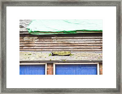 Barn Repairs Framed Print
