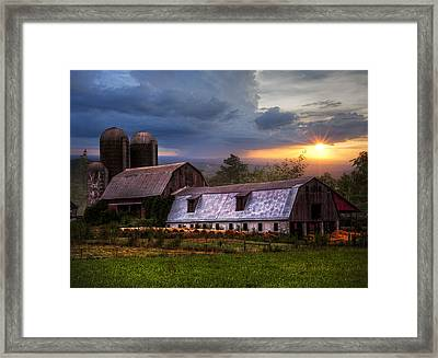 Barns At Sunset Framed Print by Debra and Dave Vanderlaan