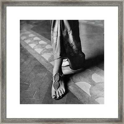 Baroness Reutern's Feet Modeling Sandals Framed Print by Marya Mannes