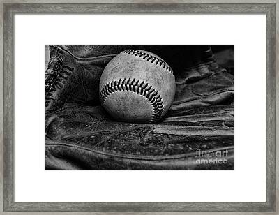 Baseball Broken In Black And White Framed Print by Paul Ward