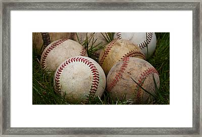 Baseballs On The Grass Framed Print by David Patterson