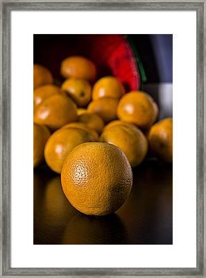 Basket Of Oranges Framed Print by Jeff Burton