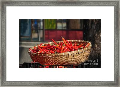 Basket With Red Chili Peppers Framed Print by Yali Shi