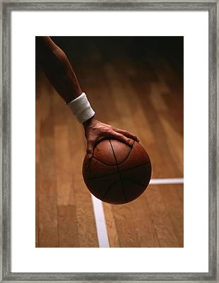 Basketball Ball In Male Hands Framed Print