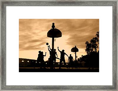 Basketball Players At Sunset Framed Print
