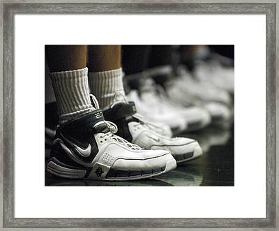 Basketball Shoes In A Row Framed Print by Replay Photos